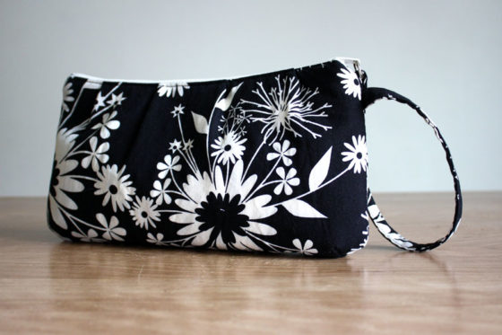 Black wristlet with cream colored flowers