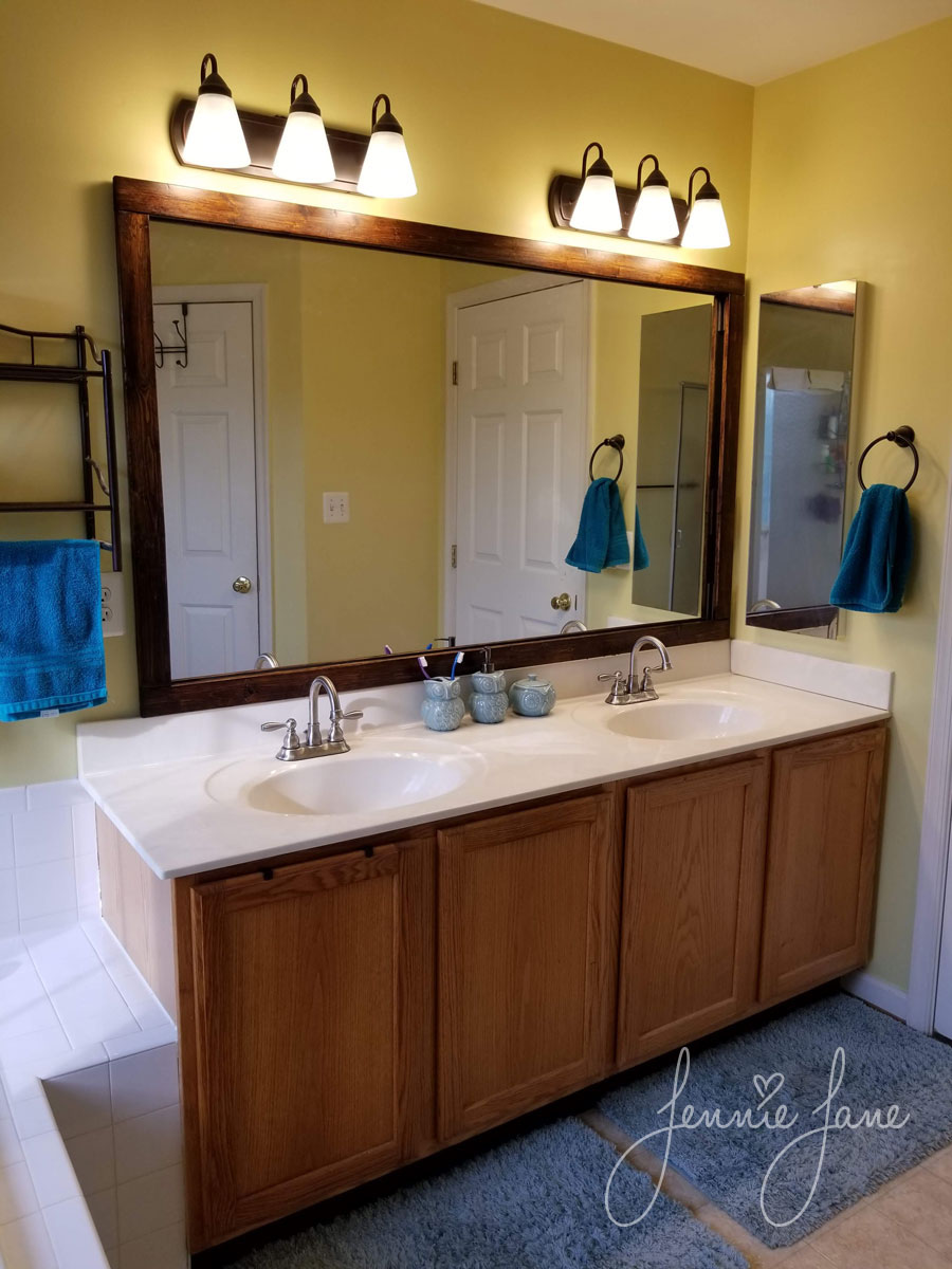 Master bathroom with DIY framed mirror