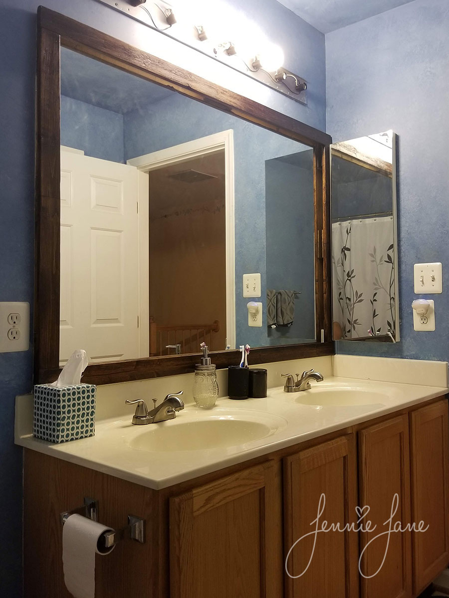 Hall bathroom with framed mirror